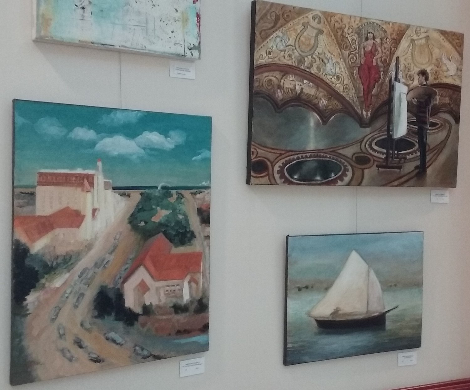 Several works of art are seen on one wall.