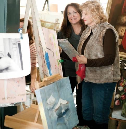 Nancy Scelsa (left) runs an oil painting class at the Nancy Stephen Gallery in East Greenwich