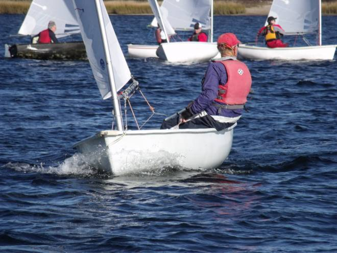 A member of the Wickford Frostbite Association's Sea Dog Fleet 166 hits the water for some winter sailing
