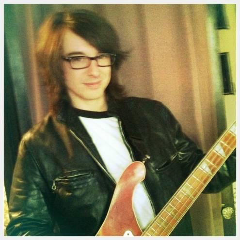 Jonas Parmelee plays bass in The Silks