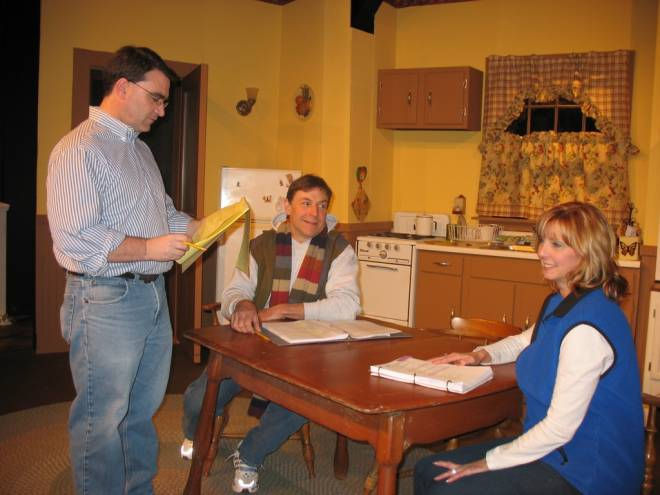 Director Brian Olsen works with actors David LaRocque and Lorie Olsen on The Affectations of May at Westerly's Granite Theatre
