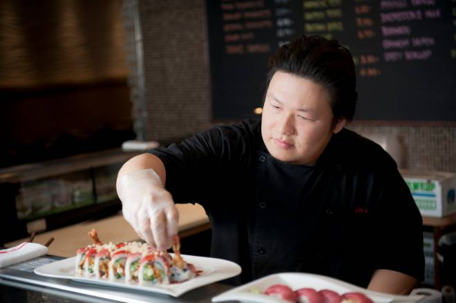 Nookky Pinwanish prepares sushi at Lim's in Wayland Square