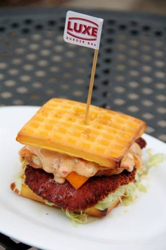 Wakefield's Laura Hebert created this Chicken-N-Waffle Burger, which won Luxe Burger Bar's Build Your Own Burger Contest