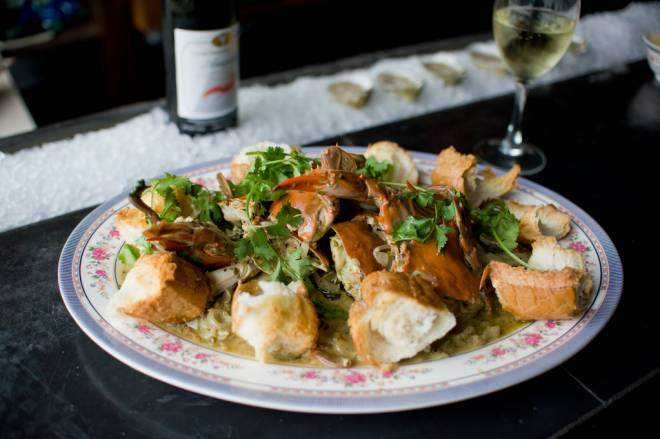 Pile Of Crabs with green chiles, cilantro, and papo seco rolls