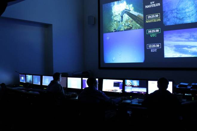 Scientists man the controls of underwater exploration vessels at Inner Space Center's mission control