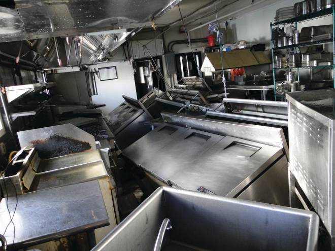 The devastated kitchen at the Coast Guard House after Superstorm Sandy