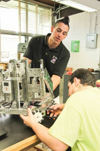 Teacher Ryan Garrity is the head of Mount Hope High School's Robotics and Engineering Club