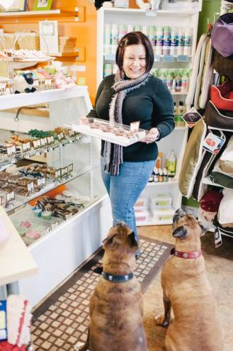 Woof! Woof! Pet Boutique proprietor Sherri Dechaine greets some hungry customers
