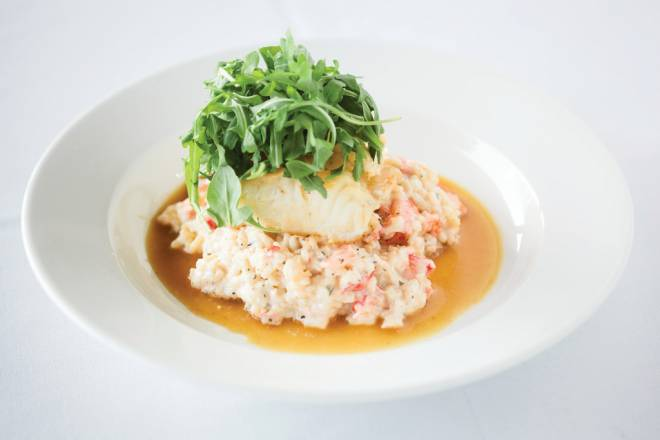 Spigola: Chilean Sea Bass, served over lobster risotto  with a saffron shrimp broth
