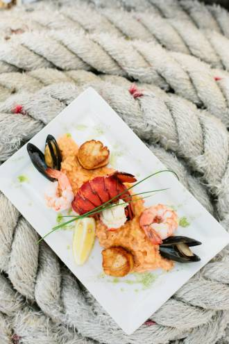 Grilled Seafood Risotto with shrimp, scallops, mussels, lobster tail and Newburg sauce