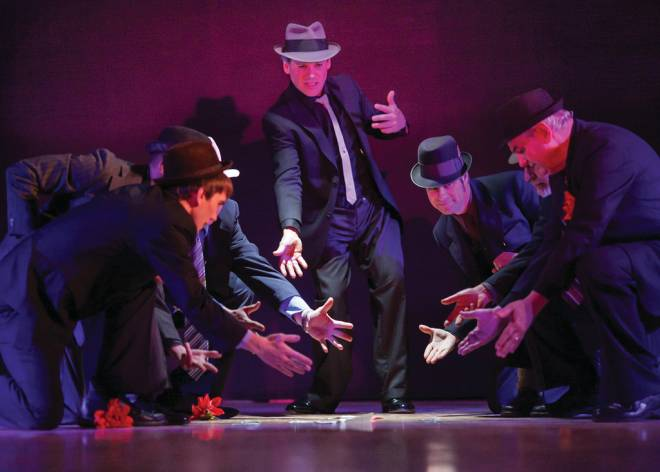 The gamblers take bets in  Guys and Dolls