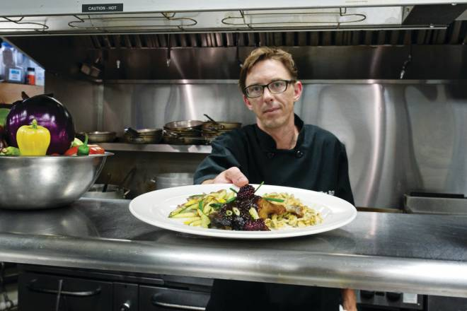 Travis Lawton in the kitchen at The roI
