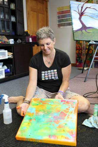 Kim Ellery at work on one of her three dimensional pieces