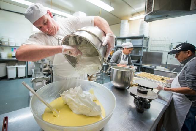 Pastry chef Scot Stegman prepares a vanilla sponge cake base at Pastiche