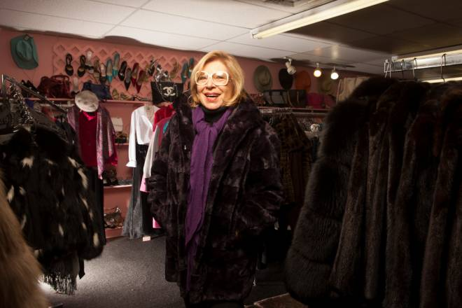 Brenda Trillo is modeling a shear dyed plum mink coat designed by Louis Feraud at her resale boutique Jazzy