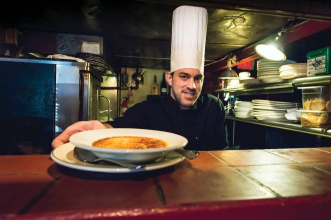 Exective chef Jack Paschke with Pot au Feu's famous Crème brûlée