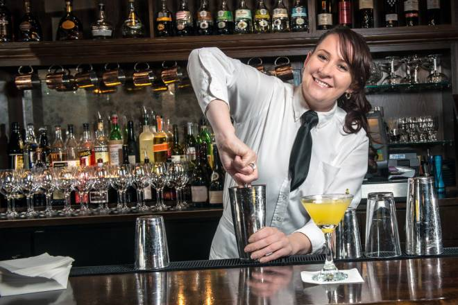 Shawna Dietz mixes up fresh cocktails at Mill's Tavern