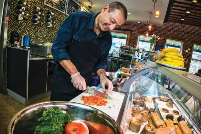 Owner and Executive Chef of L'artisan Cafe & Bakery Ghassan Daou whips up some fresh tabouli