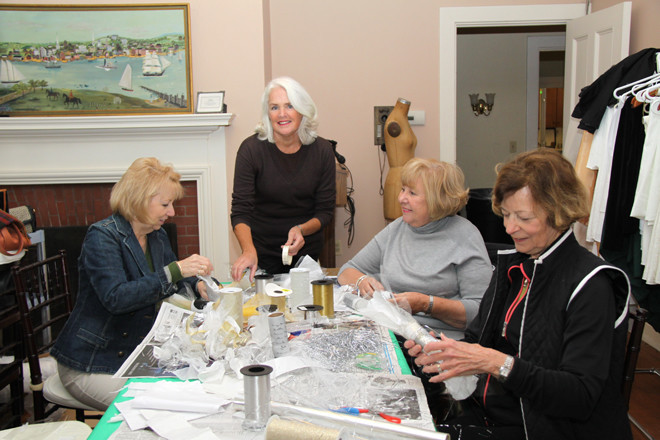 Designer Joanne Murrman (standing), with Blithewold volunteers Gail Whitford, DMargaret Charbomneau and Nancy Dupont