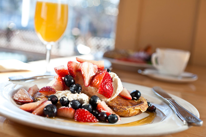 Grand Marnier French Toast with whipped cream berries and local maple syrup