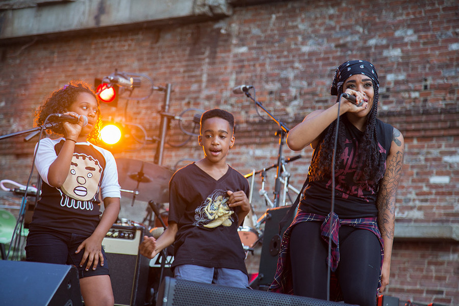 Medusah Black (Angel Newmann) performing on stage with her kids at last summer's Providence International Arts Festival