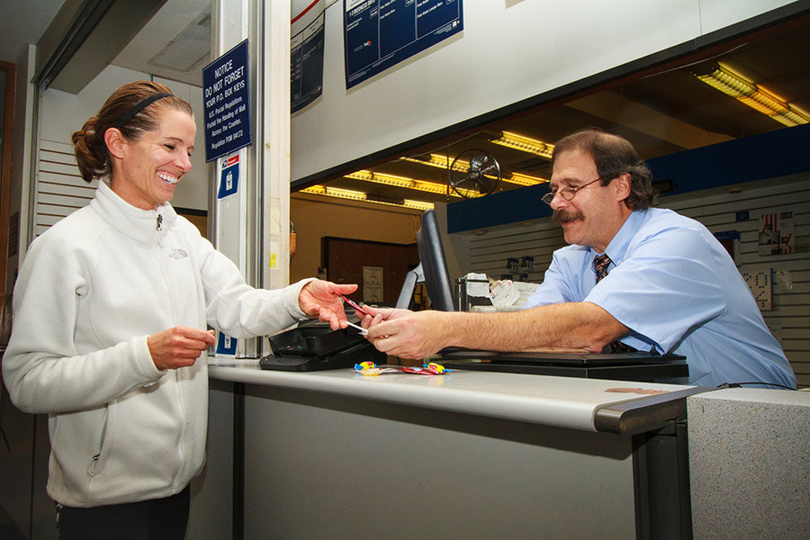 Postal Clerk Tom Vaccaro makes trips to the post office a sweet experience for his customers