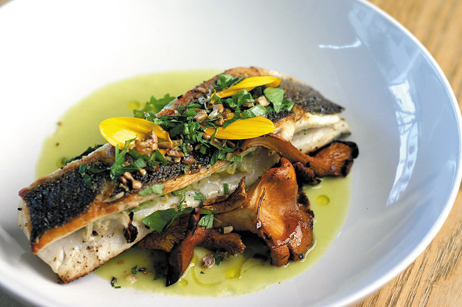 Roasted Branzino with chanterelles, kale sprouts and   sunflower gremolata