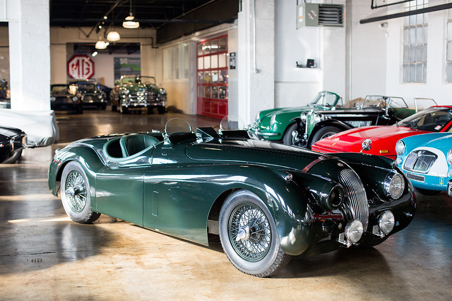 A 1953 Jaguar XK120 is one of the many envy-inducing vintage cars in Oxford Motorcars' showroom