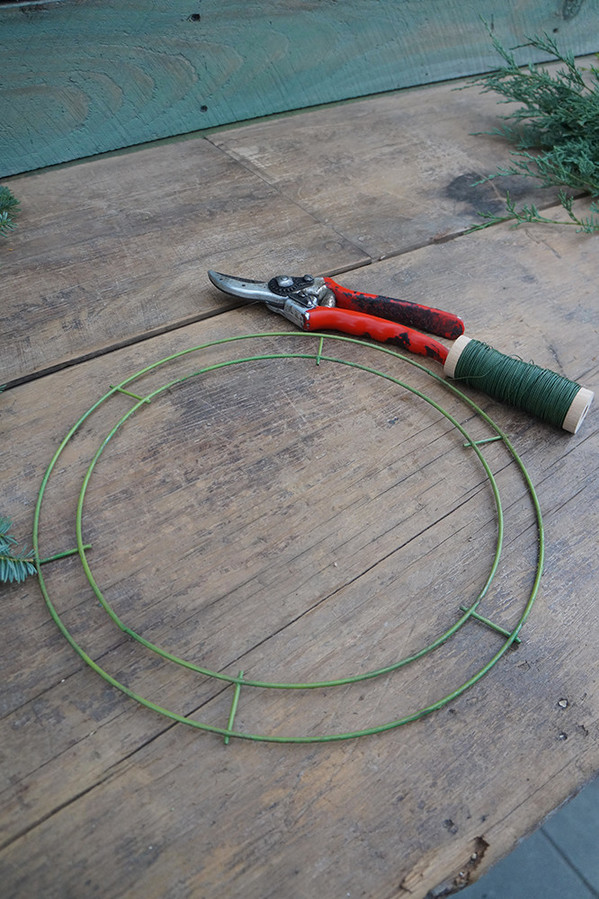 Step 1:   You will need a 12-inch wreath hoop (the standard door wreath size that can be found at your local craft store), some floral wire (Sarah recommends 20 gauge for the best flexibility and strength) and a pair of garden shears.