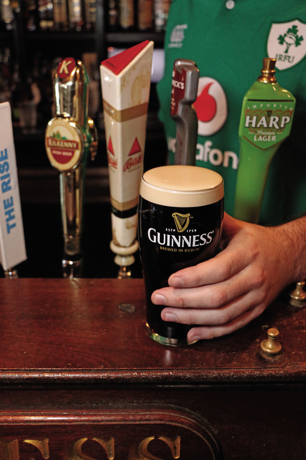 A perfectly poured Guinness – which is harder than it looks – is all part of the traditional Irish atmosphere at The Fastnet Pub