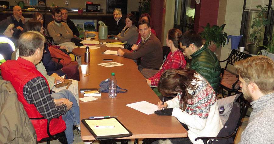 SNA President Dean Weinberg presides Jan. 10 at the meeting at Summit Commons to approve the neighborhood garden board and bylaws