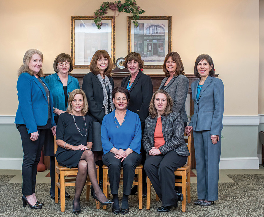The women on Saint Elizabeth Community's leadership team play a vital role in moving elder care forward in Rhode Island.   Pictured left to right, sitting: Dottie Santagata, Administrator, Cornerstone Adult Day Services; Maggie Connelly, Administrator, Saint Elizabeth Court;   Christine McGuire, Director of Finance, Saint Elizabeth Community. Standing: Mary Rossetti, Director of Community Outreach, Saint Elizabeth Community; Sharon Garland, Chief Philanthropy Officer, Saint Elizabeth Community; Beth Russell, Administrator, Saint Elizabeth Manor; Caroline Rumowicz, Director,   Cathleen Naughton Associates; Kathy Parker, Director of Admissions, Saint Elizabeth Home and Saint Elizabeth Manor; Roberta Merkle, Executive Vice   President of Strategic Initiatives, Saint Elizabeth Community.