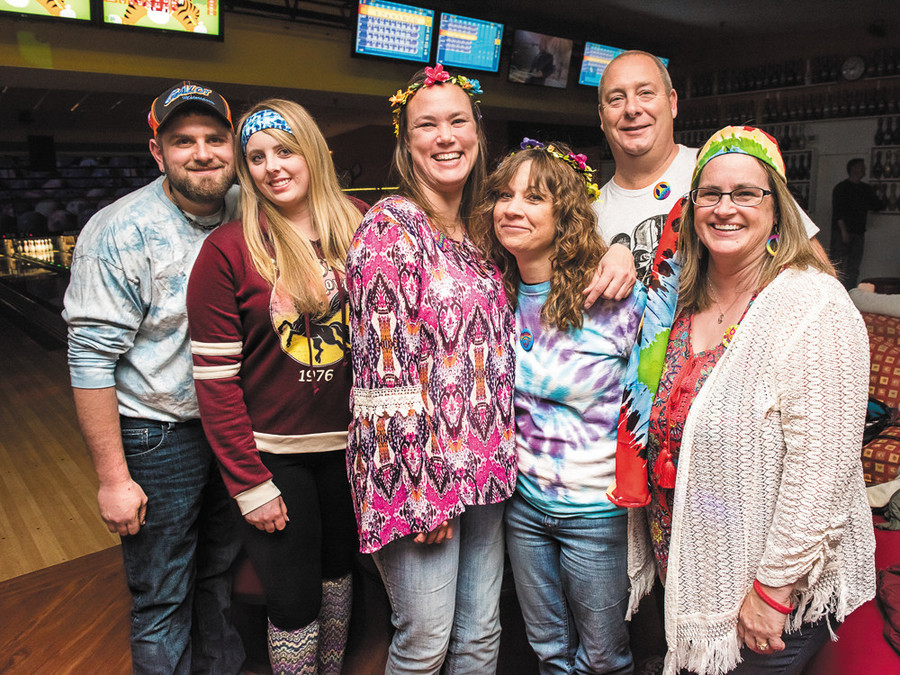 Dressed in '70s attire, people celebrate Alley Katz Bowling Center's 5th annual Super '70s Bowling Bash