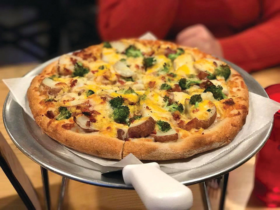If you love loaded baked potatoes but hate forks, Arcadia Pizza has you covered