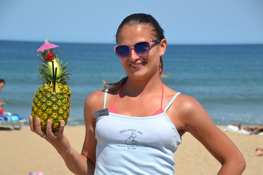 Drink out of a pineapple on the beach at Ballard's