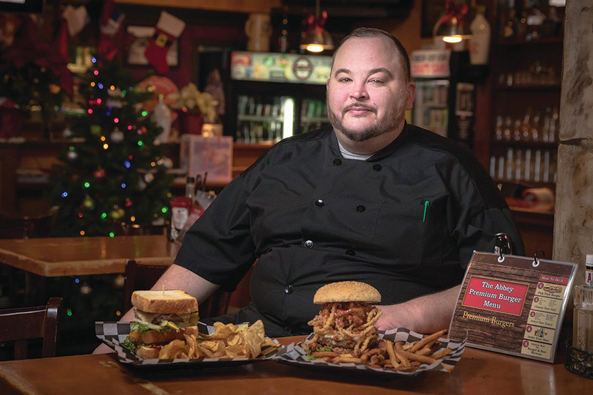 Chef Kevin Grant churns out the delicious burgers that have kept the Abbey going strong