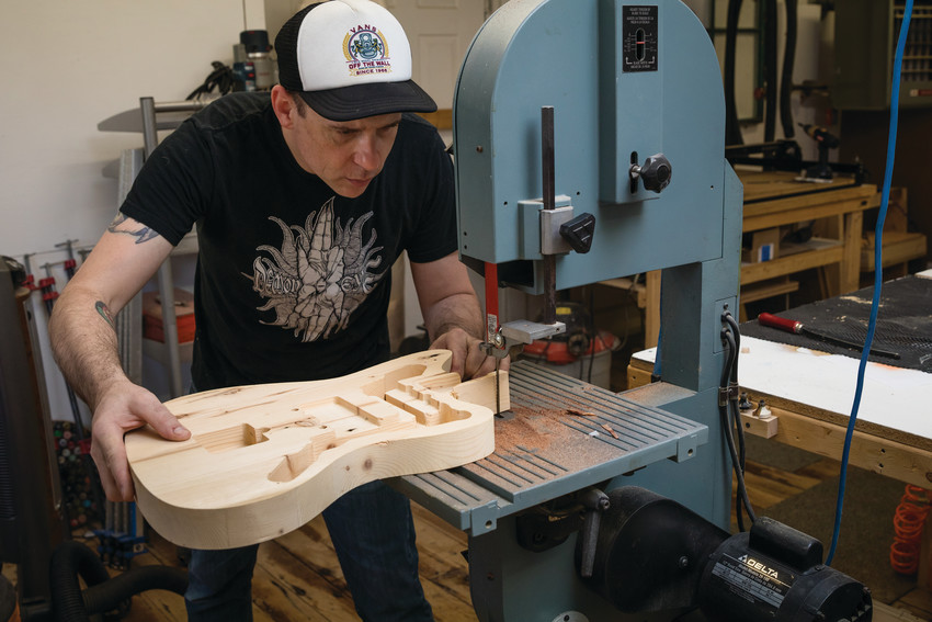 Bill Paukert, luthier and owner of Unified Guitar Works in Warren, creating a guitar from reclaimed wood.