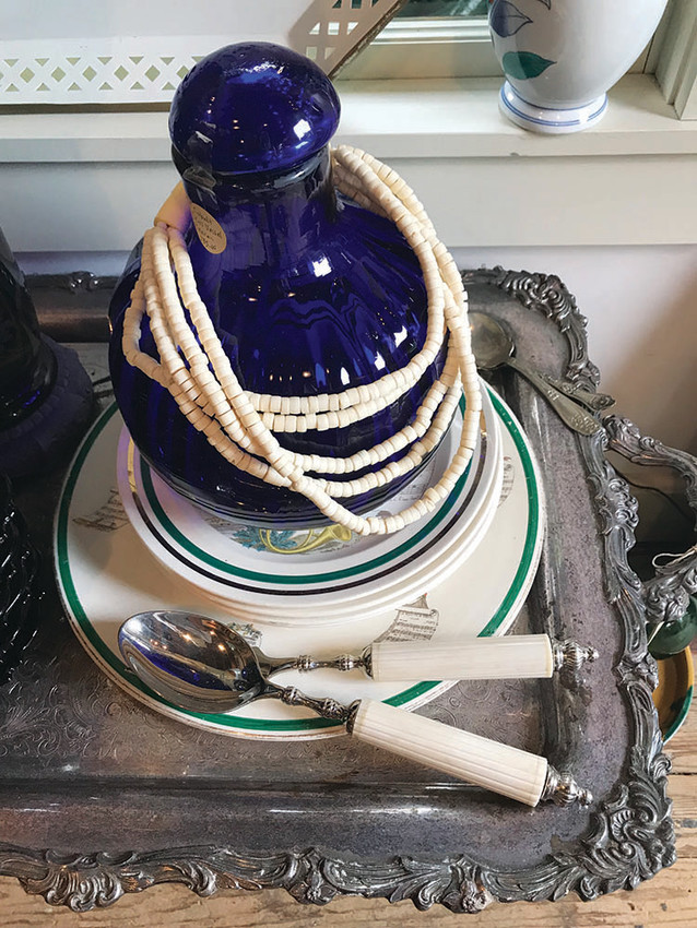 Vast cobalt bottle, $145; 1940s bone necklace, $45; Bone handled salad set, $24; Silver-plate butlers tray table, $125
