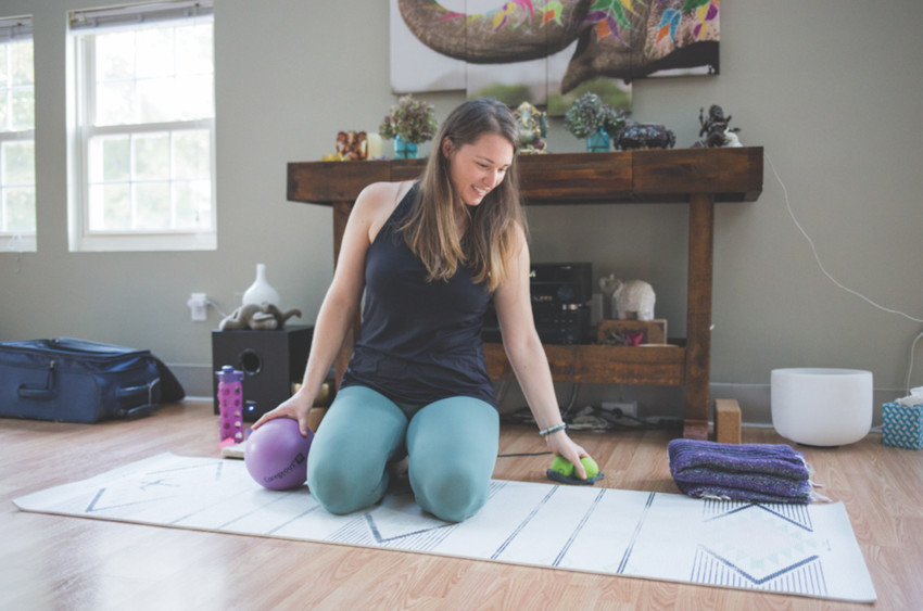 Rubber spheres help yoga practitioners roll, recover, and realign at Laughing Elephant Yoga