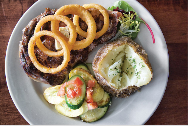 Ribeye steak with veggies of the day and baked potato