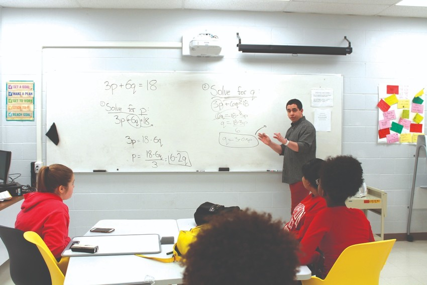 Oscar Puente teaches math to P-TECH students at North Providence High School
