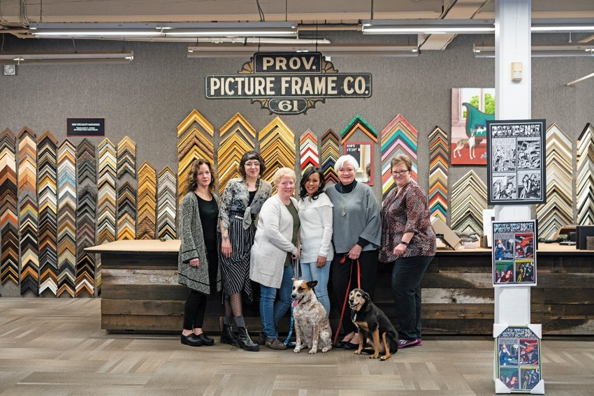 The Leading Ladies at Providence Picture Frame, left to right: Miranda Harreys, Mary Lindberg, Lisa Bushee, Diolinda Pereira, and Lisa Lagory, and PPF mascots Edie and Emma