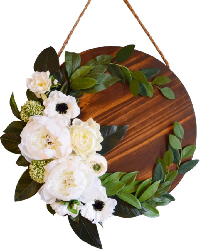 Thanks to a wide mix of faux fruits and florals, wreaths can be reused time and time again, inside or outside. The Bread and Butter Wreath, $129.