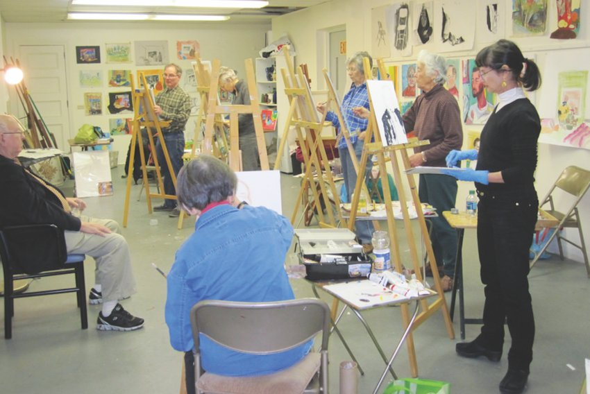 Members can take classes in applied arts, like this painting instructional