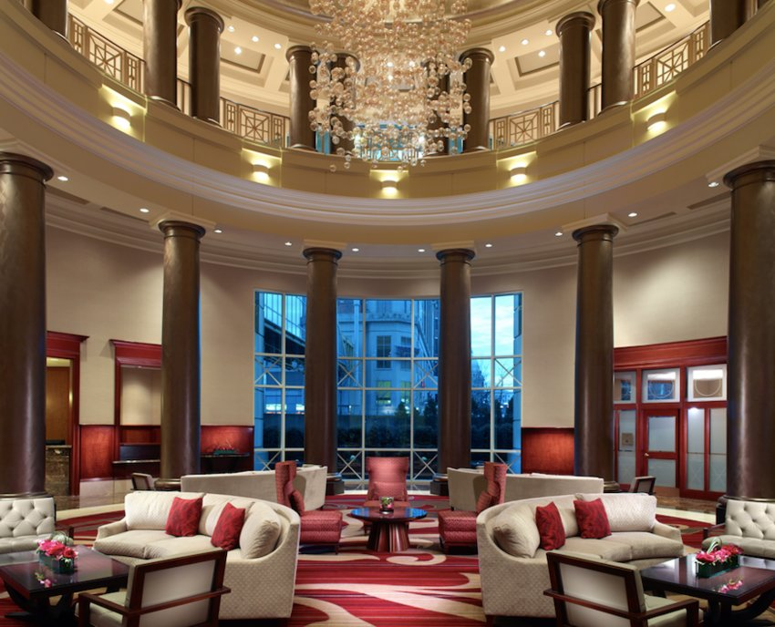 The impressive Omni Providence Hotel lobby complete with  stunning views of the city