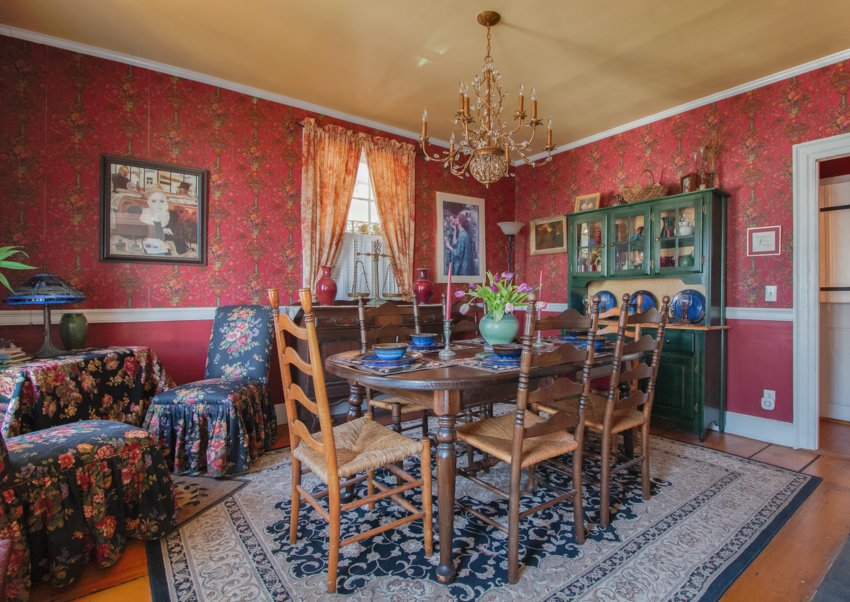 Wallpaper featuring lions and tigers hidden within the motif are among  many whimsical touches
