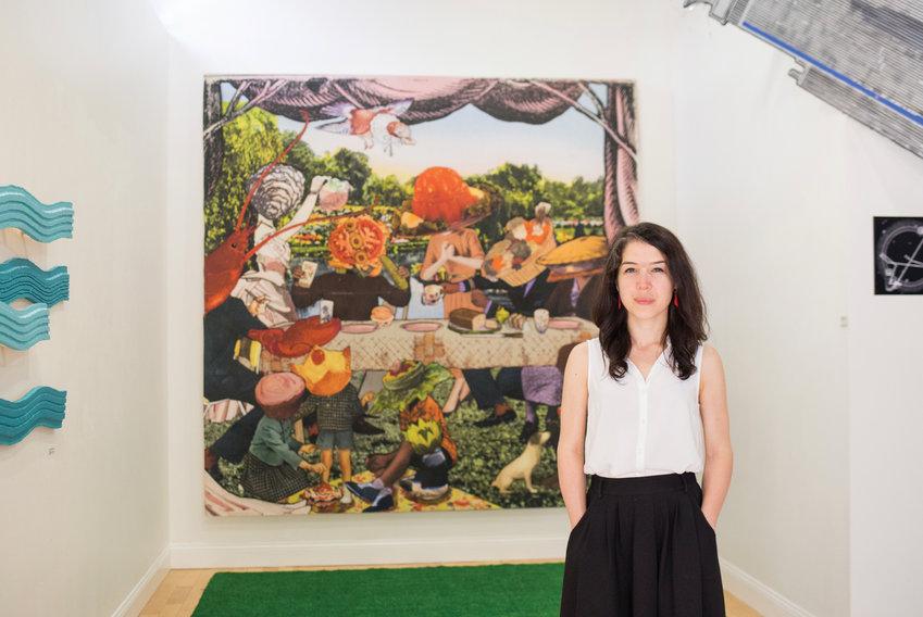 Keri in front of her dinner party mural