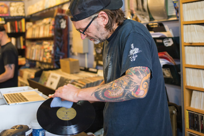 Chris Andries taking good care of vinyl