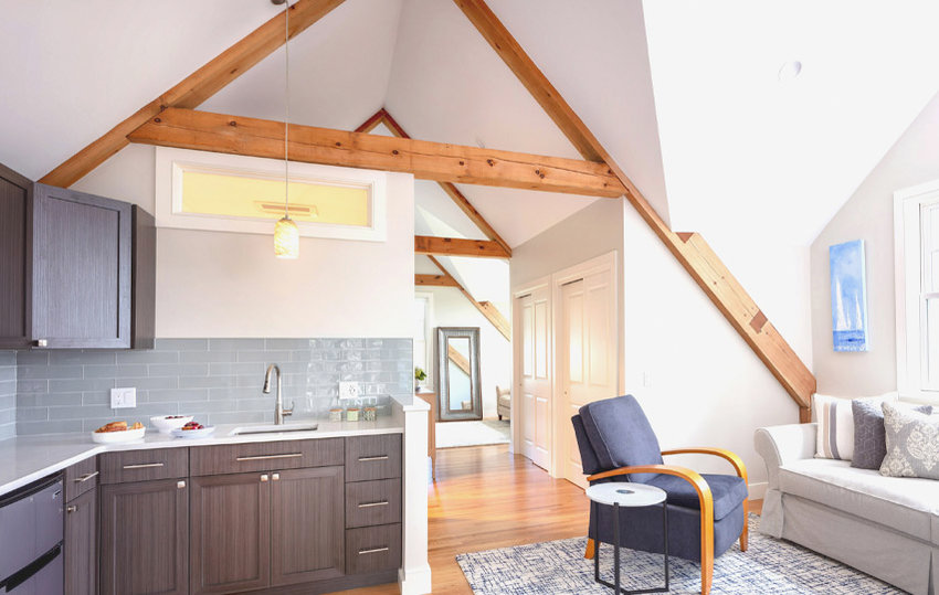 Natural wood beams are at once modest and modern in the boathouse