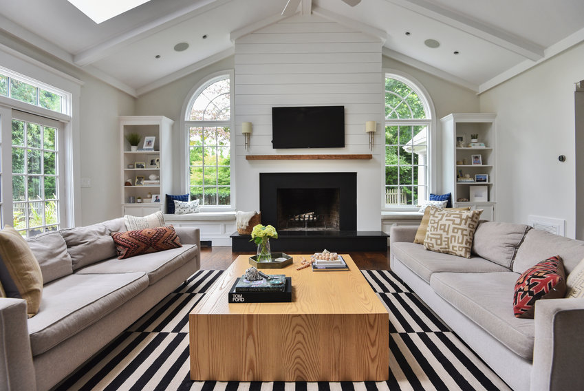 Bold patterned rugs add visual interest to any space, especially when surrounding furnishings are kept neutral and with simple lines